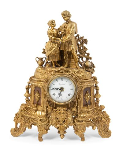 A Louis Philippe Gilt-Metal Figural Mantel Clock Height 18 x width 14 1/2 x depth 4 1/2 inches.