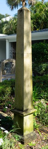 A Pair of Carved Stone Obelisks Height 85 x base, 13 inches square.