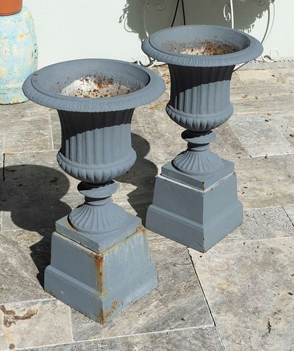 A Pair of Cast Iron Campana-form Jardinieres on Pedestals Height 27 x diameter 15 inches.