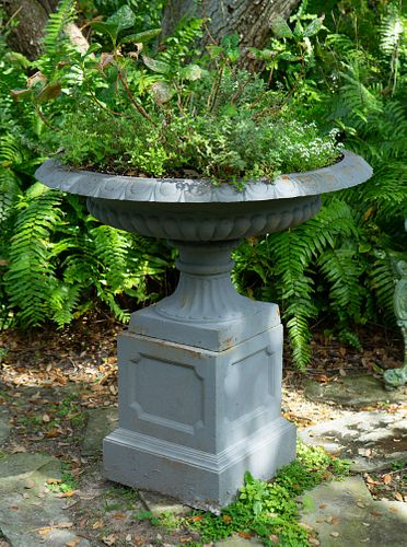 A Pair of Cast Iron Shallow Campana-form Jardinieres on Pedestal Bases Height 38 x diameter 37 inches.