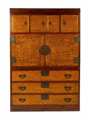 A Japanese Kiri Wood Tansu Height 69 1/4 x width 46 x depth 19 1/4 inches.