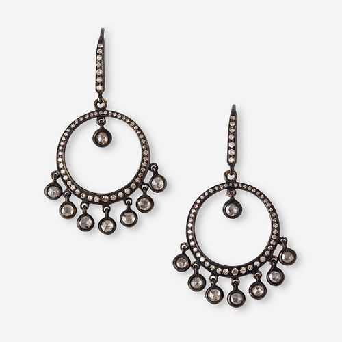 A pair of diamond and silver topped eighteen karat gold earrings,
