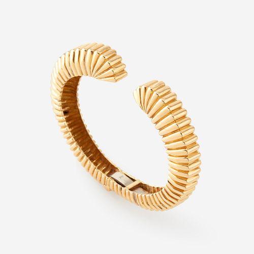 An eighteen karat gold cuff,