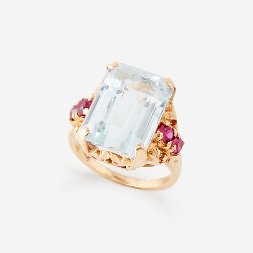 An aquamarine, ruby, and fourteen karat gold ring,
