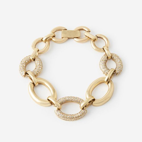 A eighteen karat gold and diamond bracelet,
