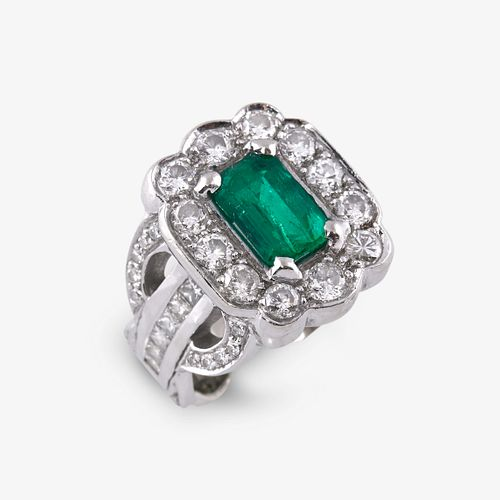 An emerald, diamond, and platinum ring,