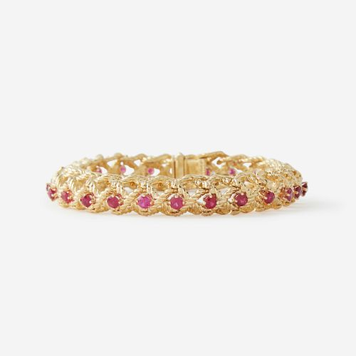 An eighteen karat gold and ruby bracelet, Cartier,