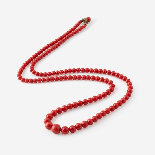 A coral bead necklace,