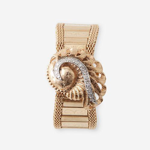 A fourteen karat gold and diamond, covered dial bracelet wristwatch, c. 1940's
