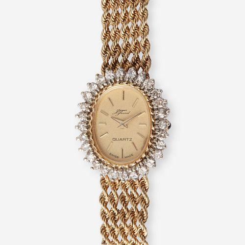 A fourteen karat gold and diamond, bracelet wristwatch,