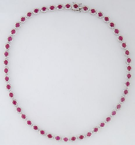 Platinum Link Necklace, each of the 50 oval links with a central oval ruby atop a border of tiny round diamonds, total ruby wt.- 19.13 cts., total dia