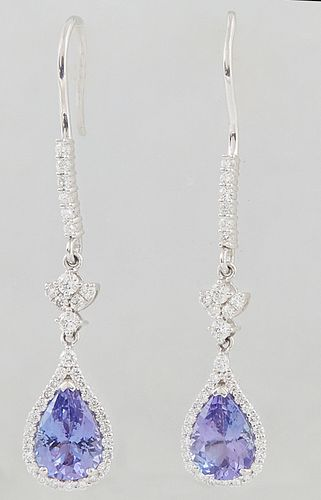 Pair of Platinum Pendant Earrings, with a diamond mounted hook to a diamond mounted floriform link, suspending a pendant with a pear shaped 1.89 ct. t