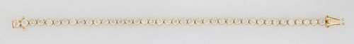 14K Yellow Gold Tennis Bracelet, each of the forty links mounted with a round diamond, total diamond wt.- 8.52 cts., L.- 7 1/2 in., with appraisal.
