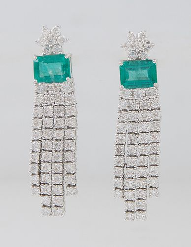 Pair of Platinum Pendant Earrings, the diamond mounted florifom stud suspending a 1.64 ct. emerald atop a double border of round diamonds, suspending