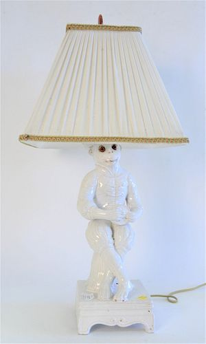 White Porcelain Crowned Seated Monkey, having red glass eyes, on square base, made into a table lamp, monkey height 16 inches.