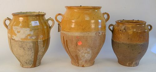 Group of Ten French Earthenware Glazed Confit Jars, with handles in mustard yellow drip glaze, height 13 1/2 inches.