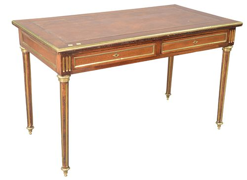 """Louis XVI Style Desk, having leather top with brass trim, two drawers on fluted brass trimmed legs, height 29 inches, width 48 inches, top 25"""" x 47""""."""