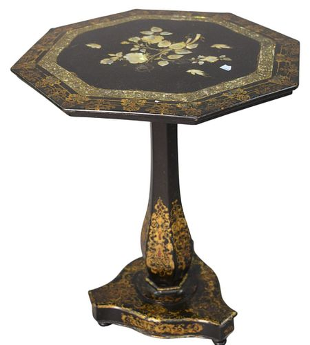 Victorian Paper Mache and Black Laquered Table, having mother of pearl inlay and gilt decoration, height 24 3/4 inches, diameter 21 inches.