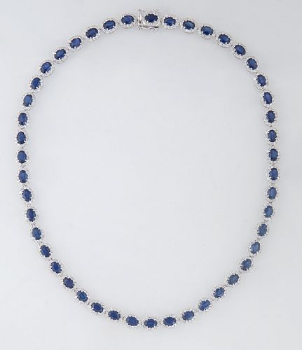14K White Gold Link Necklace, each of the forty-six oval links with an oval blue sapphire atop a border of round diamonds, total sapphire wt.- 26.11 c