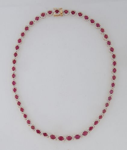 14K Yellow Gold Link Necklace, each of the fifty links with a graduated oval ruby atop a border of round diamonds, total ruby wt.- 27.54 cts., total d