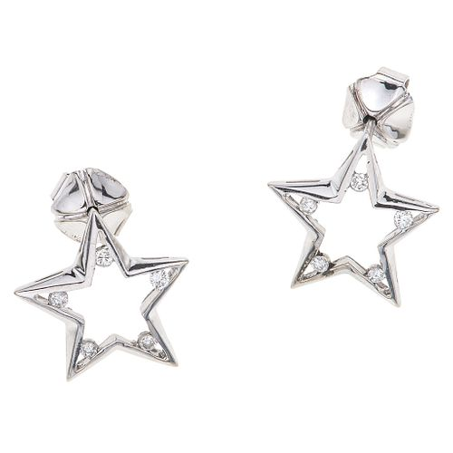 PAIR OF STUD EARRINGS WITH DIAMONDS IN 14K WHITE GOLD 10 Brilliant cut diamonds ~0.25 ct. Weight: 4.1 g