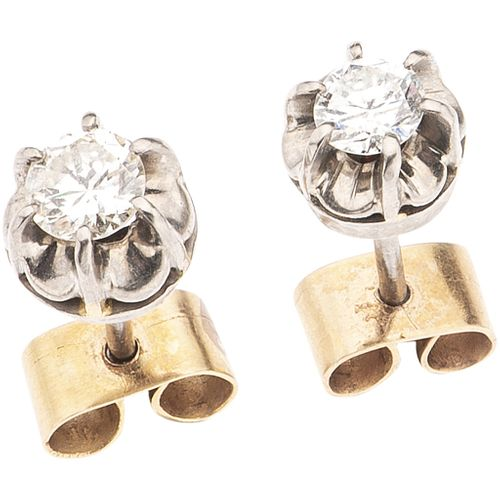 PAIR OF STUD EARRINGS WITH DIAMONDS, 18K WHITE AND YELLOW GOLD 2 Brilliant cut diamonds ~0.61 ct Clarity: SI2- I1 Color: J-K
