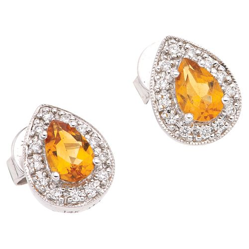 PAIR OF STUD EARRINGS WITH CITRINES AND DIAMONDS IN 14K WHITE GOLD 2 Pear cut citrines ~0.80ct, 26 Brilliant cut diamonds ~0.08ct