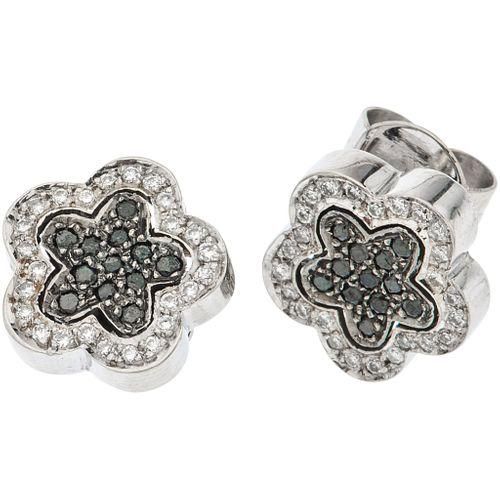 PAIR OF STUD EARRINGS WITH DIAMONDS IN 18K WHITE GOLD 24 Black diamonds, 50 Brilliant cut white diamonds ~0.65 ct