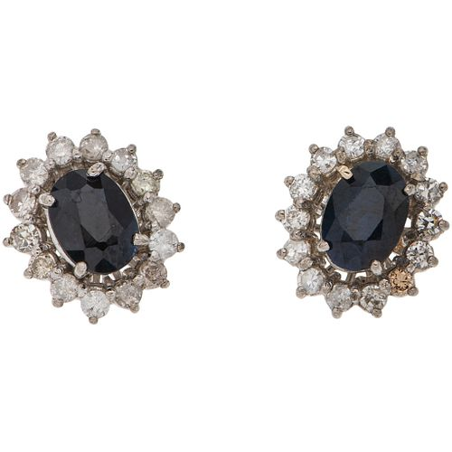 PAIR OF STUD EARRINGS WITH SAPPHIRES AND DIAMONDS IN 14K WHITE GOLD 2 Oval cut sapphires ~1.70 ct, 28 8x8 and brilliant cut diamonds