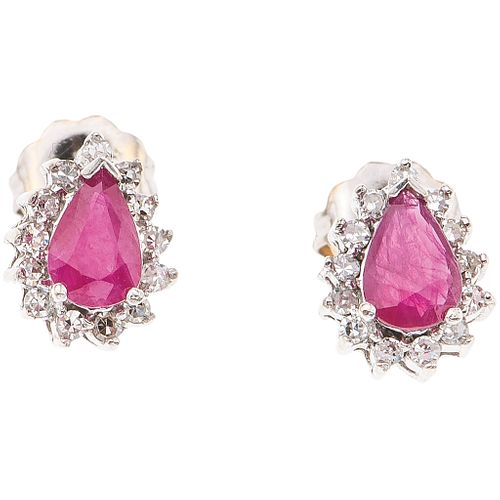 PAIR OF STUD EARRINGS WITH RUBIES AND DIAMONDS IN 14K WHITE GOLD 2 Pear cut rubies ~0.70 ct, 26 8x8 cut diamonds ~0.26 ct