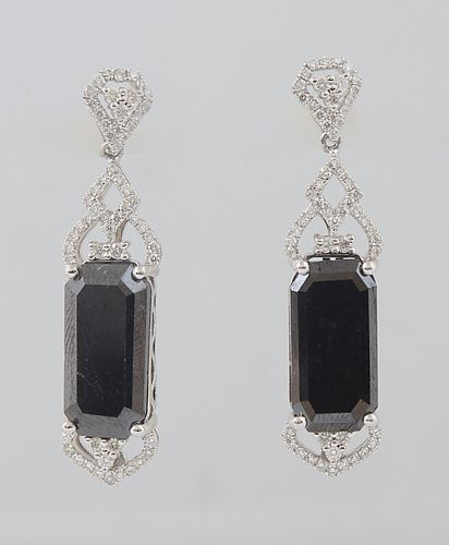 Pair of Platinum Pendant Earrings, with diamond mounted studs to rectangular 7.26 ct. black diamonds, the tops and bottoms of the black diamond with p