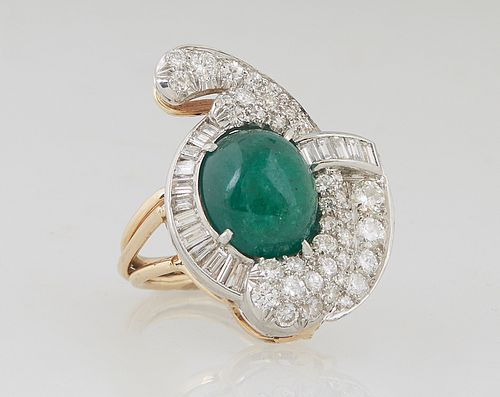 Lady's 14K Yellow Gold Dinner Ring, with an oval cabochon 10 ct. emerald, within a swirled border of round and baguette diamonds, on a split shouldere
