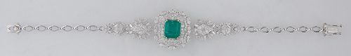 18K White Gold Victorian Style Link Bracelet, the center with a 3.75 ct. emerald atop two graduated concentric scalloped borders of round diamonds and