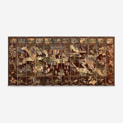 "A Chinese carved twelve-panel ""Coromandel"" folding screen 17th/18th Century"