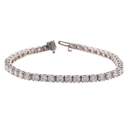 An 8.35 ctw Round Diamond Tennis Bracelet in Plat