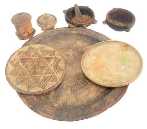 Eight Piece Group of Woodware to include a large burlwood treenware charger or serving plate, diameter 20 1/2 inches, small serving ladle, an American