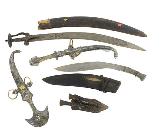 Group of Six Knives and Daggers to include two Middle Eastern daggers with silvered and brass sheath and handle, an Indian sword with jeweled handle a