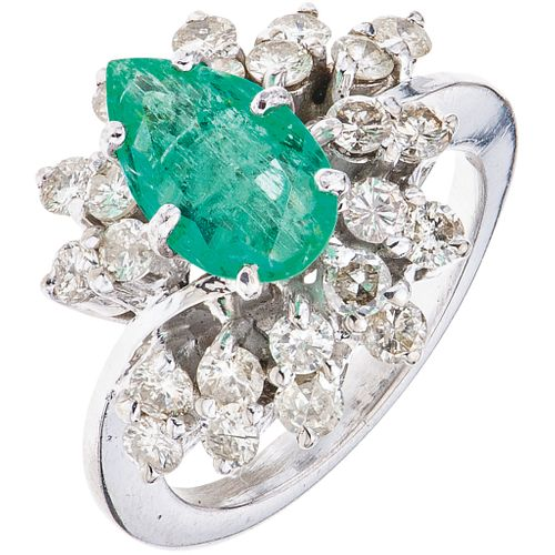 RING WITH EMERALD AND DIAMONDS IN 10K WHITE GOLD 1 pear cut emerald ~1.0 ct and 24 brilliant cut diamonds. Size: 7