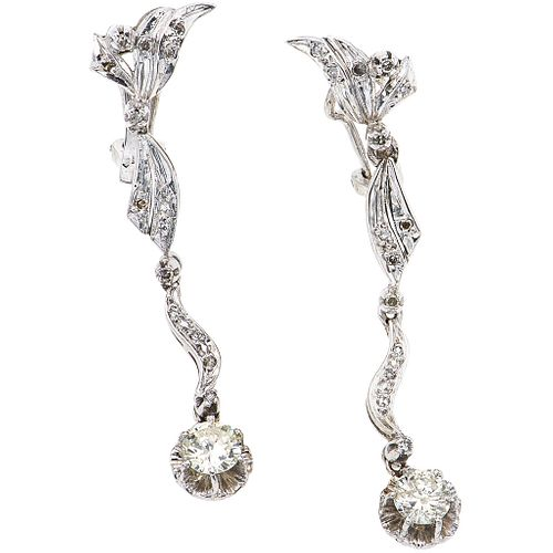 PAIR OF EARRINGS WITH DIAMONDS IN PALLADIUM SILVER with 2 brilliant cut diamonds ~1.0 ct. Clarity: I1-I3 Color: J-K and 28 diamonds