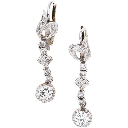 PAIR OF EARRINGS WITH DIAMONDS IN PALLADIUM SILVER with 2 brilliant cut diamonds ~0.70 ct Clarity: VS2 Color: J-K y 16 8x8 cut diamonds
