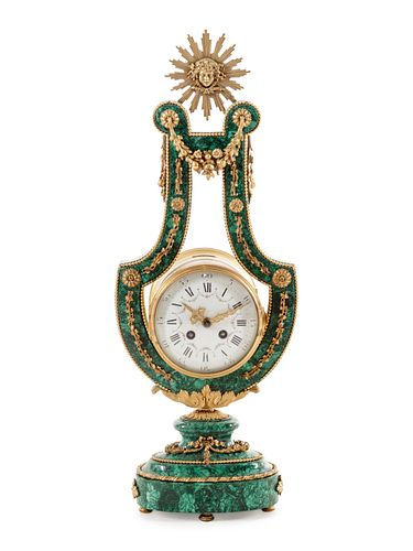 A Louis XIV Style Gilt Metal Mounted Malachite Veneered Harp Clock