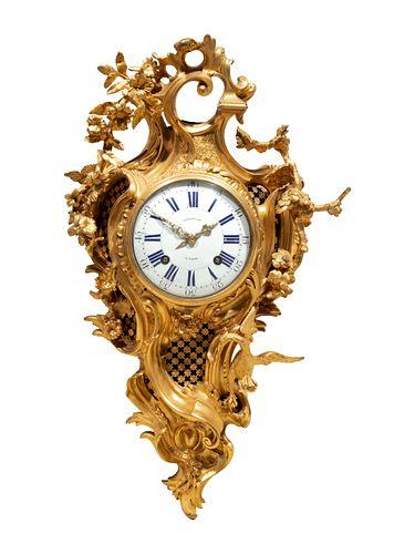 A Louis XV Gilt Bronze Cartel Clock