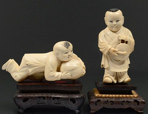 TWO CARVED IVORY FIGURES OF BOYS