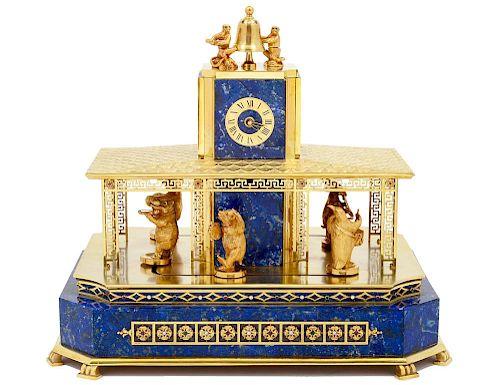 RARE EIGHTEEN KARAT GOLD, LAPIS LAZULI AND PRECIOUS STONES AUTOMATED MANTEL CLOCK