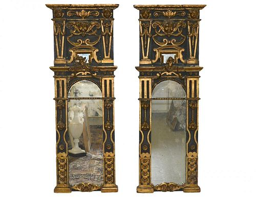 PAIR OF BAROQUE STYLE PARCEL GILT AND CARVED WOOD MIRRORS