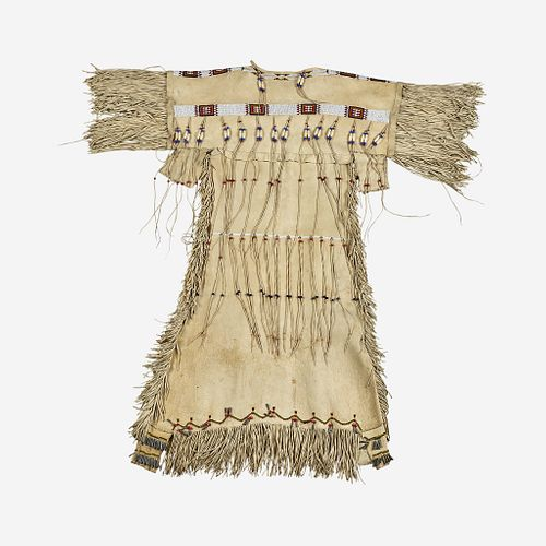 A Southern Plains beaded hide dress with tinklers 20th century
