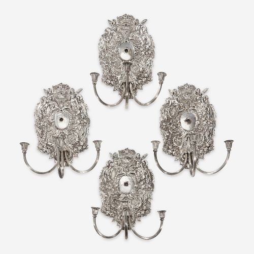 A set of four William & Mary style silverplated wall lights late 19th/early 20th century