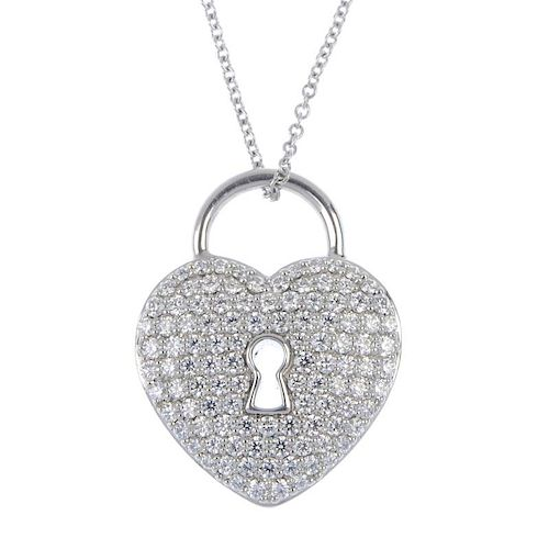 7fc4a1003 TIFFANY & CO. - a diamond 'lock' pendant. Designed as a pave-set ...