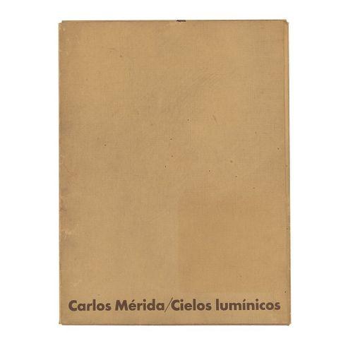 Mérida, Carlos. Cielos Iluminados. México: Galería Arvil, 1979.  Con 10 reproducciones de las serigrafías a color, firmadas y fechad...