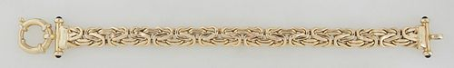 """14K Yellow Gold """"Wheat"""" Bracelet, 20th c., the ends with onyx mounted bars, with a maker's mark of a sideways """"S"""" in a diamond, H.- 3/8 in., L.- 8 3/8"""